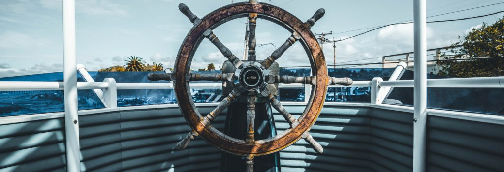Investment Management-photo of helm of boat on water Financial Future Services Monument Colorado
